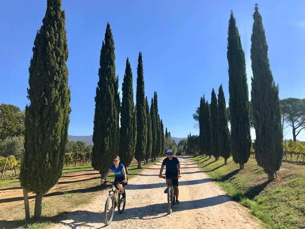 best towns in Tuscany - bike riding through vineyards