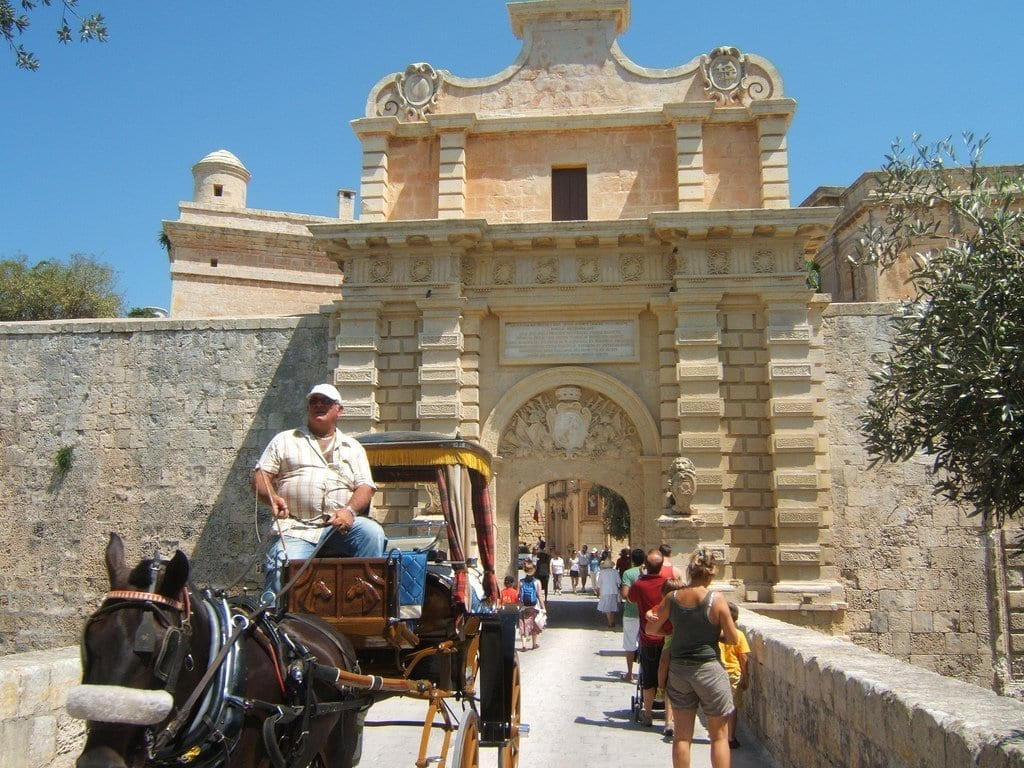 Mdina city gate picture and horse carriages in beautiful malta