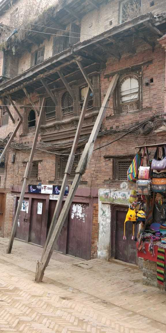 About nepal - wood beams holding up homes and businesses